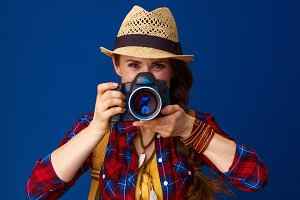 young traveller woman taking photo with digital camera