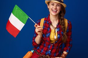 happy active tourist woman isolated on blue with flag of Italy