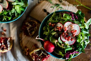 Rustic bowls of salad with radish
