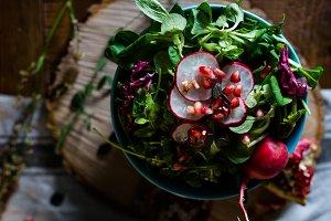 Rustic bowl of salad with radish