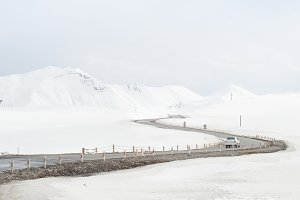 Car on a winter mountains road