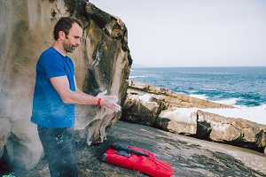 Climber coating hands in magnesium