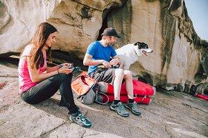Young climbers putting climbing shoe