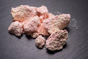Pink bath salt on black
