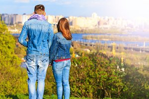 couple in the romantic city looks at the panorama of the city