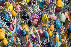 Photo of Easter tree with colorful eggs and ribbons