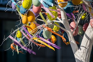 Image of Easter tree with colorful eggs and ribbons