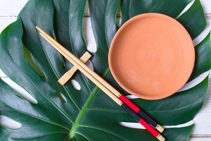 Chopstick and ceramic handmade dish. Asian food concept.