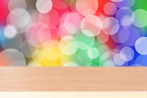 Wood table on colorful background
