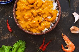 Shrimp in curry sauce with rice. View from above.