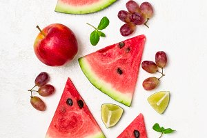 Fresh watermelon and fruits on white background. Pattern of watermelon slices