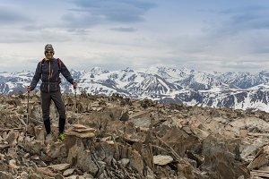 Man on peak of mountain. Conceptual design