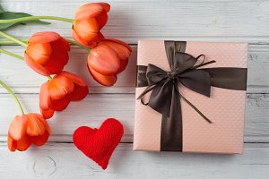 Red bouquet of tulips and gift boxed