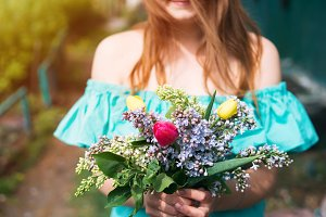 Young woman with a spring bouquet