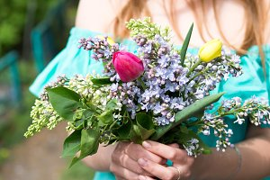 Young woman with a spring bouquet of