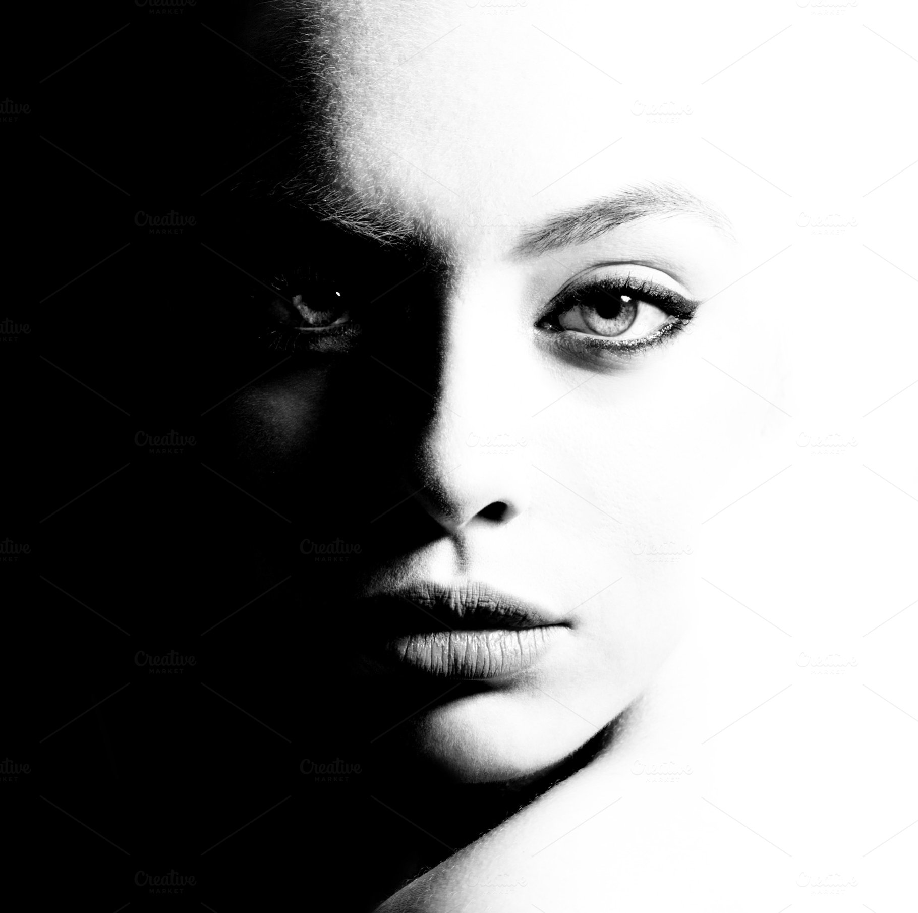 High contrast black and white portrait of a beautiful girl