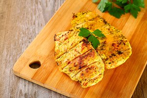 healthy food - grilled chicken with vegetables on a wooden board.