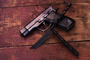Black knife. Black gun.