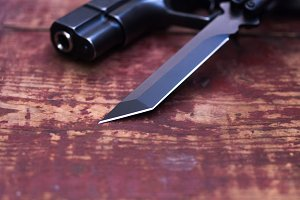 Sharper knife. The muzzle of the gun. The photo is close.