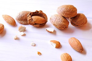 Group fo almonds on a white table