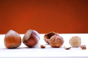 Hazelnuts on a white table