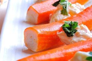 Surimi sticks with sauce closeup