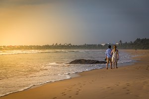couple walking on a tropical beach