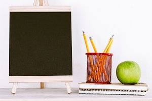 Chalkboard with school supplies