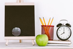 Chalkboard with school supplies