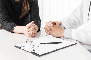 Doctor and woman patient consulting