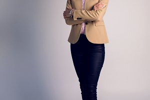 portrait of business woman in brown full length jacket