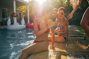Friends enjoying at pool party