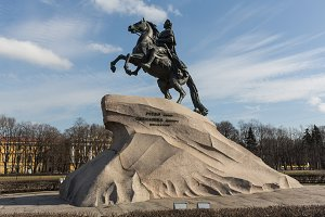 The bronze horseman monument illuminated by the evening sun in Saint-Petersburg.
