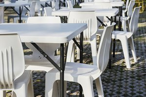 White tables and chairs in festival