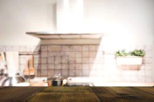Wood table on blur Interior kitchen