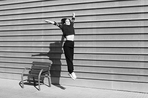 Contemporary dance on the move in an urban setting in black and white
