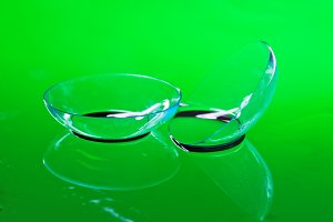 Two contact lenses lie on a mirror s