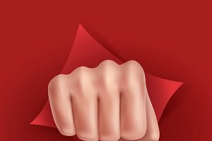Fist punching through red paper
