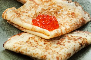 Sourdough pancakes with red salmon caviar traditional for Russian pancake week