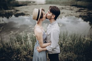 stylish hipster couple hugging