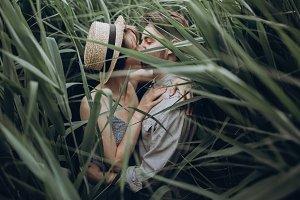 hipster couple embracing at lake