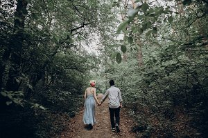 hipster bride and groom walking
