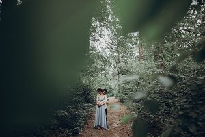 hipster couple in green forest