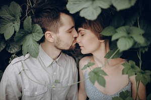 hipster couple kissing in leaves