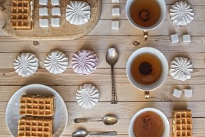 Tea with waffles and marshmallows