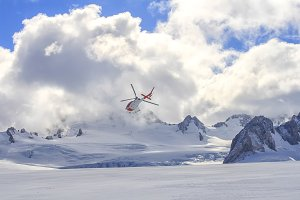 Flying helicopter on glacier