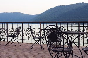 tables outside near the water.