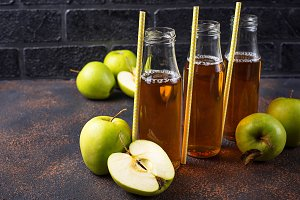 Bottles with fresh apple juice