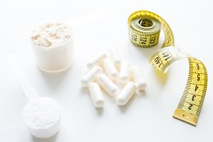 supplements and a measuring tape