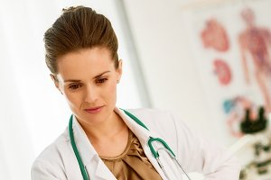 Medical doctor woman looking in laptop